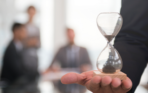 businessman-holding-an-hour-glass-signifies-the-importance-of-being-on-time
