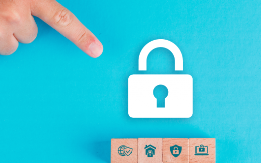 security-concept-with-wooden-blocks-paper-lock-icon-on-blue-table-flat-lay-man-hand-pointing
